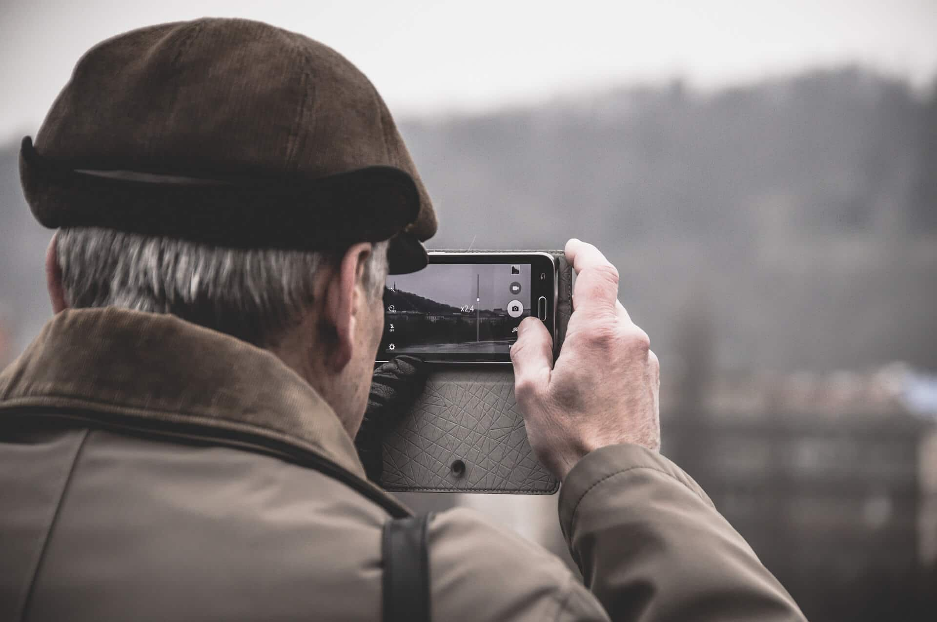 old man clicking photos